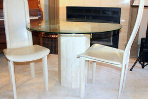 Round glass dining table. Seats 4
