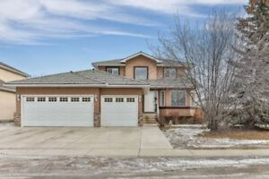 5 Bed Updated Home w/ 1 bed suite across from Chestermere Lake