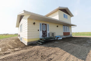 Acreage with 1920sqft One & 1/2 home 2 km from Vanscoy