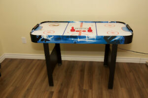 Used Air Hockey table for kids with pucks and paddles 25.00