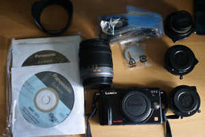 Panasonic Lumix GF2 w 14-42 mega o.i.s. kit lens in box