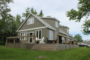 WALK to PARLEE BEACH from your house!  Home for sale Shediac