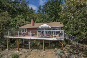 Price Reduction on this Gorgeous Waterfront Home in Maple Bay!