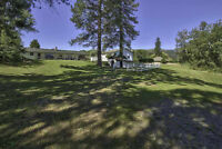 Westsyde Home on 1 Acre of Riverfront Property