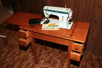 Vintage Singer Sewing machine with table and instructions