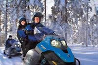 Looking for Snowmobile rental with trailer and helmets for 2