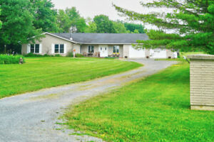 NEW LISTING Elegant country living just minutes from the city!