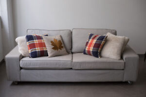 Rolling Ikea Fabric Couch with custom Casters