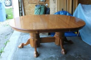 Solid oak dining table with leaves