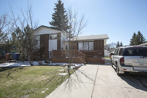 Renovated four level split with double heated garage in NW.