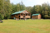 Three Bedroom Camp with 5 acres of ground.