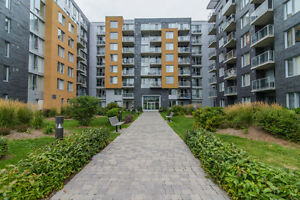 CONDO A LOUER 3 1/2 + ELECTROMENAGER + PARKING INTERIEUR