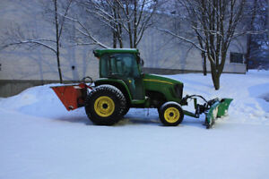 Tractor with plow available to be rented for winter