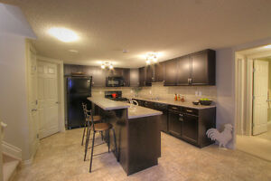 NOT YOUR TYPICAL BASEMENT SUITE – ATTACHED GARAGE, LARGE KITCHEN