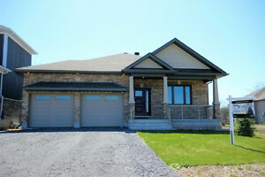 OPEN SUNDAY APRIL 30! Custom Bungalow Situated On Premium Lot