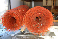 Two rolls of orange snow fence for sale