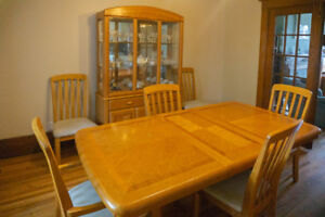 Oak finish dining set with 6 chairs, table & china cabinet