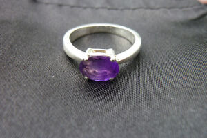 Amethyst faceted claw set ring