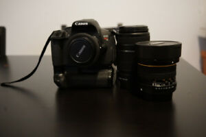 Canon T4i with 3 lenses, SD card, and battery grip extender