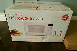 Brand New in Box GE Microwave