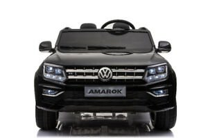 SALE!!  2 SEATER RIDE ON WITH REMOTE/ VW AMAROCK/ RUBBER WHEELS/
