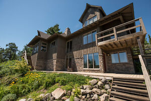 NEW PRICE! Stunning home on Oliver Lake!