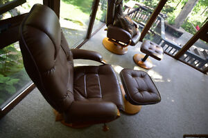 Two swivel/recliner chairs with ottmans