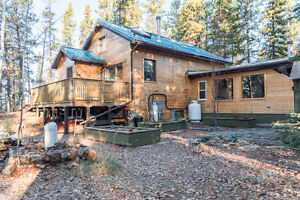 A true GEM!!! BEAUTIFUL Milled Log Home on Teslin Lake! RE/MAX®