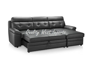 Real leather sectional sofa with pull out bed chaise for Chaise bercante kijiji