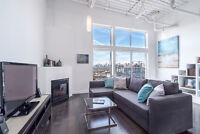 Contemporary & Sleek Penthouse Loft Living In Revered Building