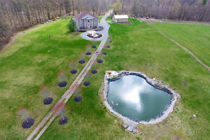 Country retreat on an absolutely beautiful 30-acre lot!