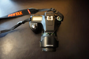 Pentax K100D DSLR camera with 2 lenses and flash