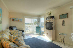 Bright Beachy Fully Furnished Condo by the Ocean!