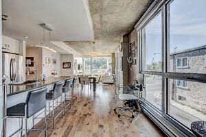 Spectacular corner unit condo facing the water in Old Montreal.