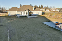 Country Acreage, city water, triple heated garage, shop + more!