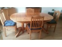 Large extendable dining table and four chairs in very good condition