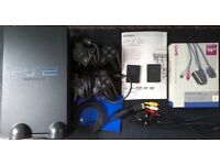 PS2 WITH CONTROLLERS , GAMES ETC EXCELLENT CONDITION £60