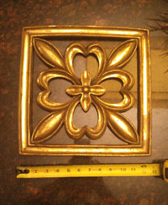 Antiqued gold decorative wall piece