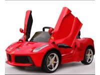 Licensed LA FERRARI 12v ride on car with remote control music and lights (leeds) only £220