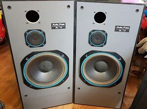 Two 12 inch speakers with midrange speakers in box