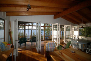 Open concept cottage on over 200 feet of private shore.