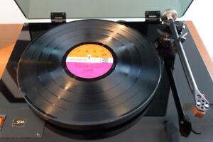 Achète collections de disques vinyle 33t & 45t, rock, jazz etc..