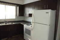 2-bedroom main floor with a large garage, close to downtown