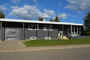 PropertyGuys 4 Bed 2 Bath Home in Southside Lethbridge