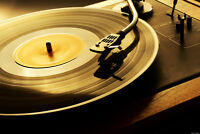 Vinyl record albums (lps) and turntable (record players)