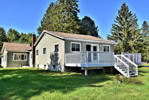 4 BEDROOM HOME ON LEVEL LOT WITH 200' ON THE BURNT RIVER!