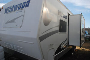 New price for like-new 23ft Wildwood Travel Trailer
