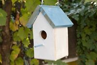 Wooden birdhouses and tables