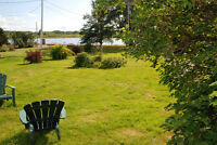 Interesting large North Shore Cottage for rent- walk to beach!
