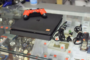 PlayStation 4 Slim + all the Hook-Up Cords + One Controller
